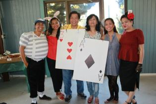 A complete family picture! From left to right – Tweedle Dee, the [dark] rabbit, card soldiers, Alice, and the Queen of Hearts