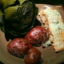 Salmon fillet, red potatoes, and artichoke