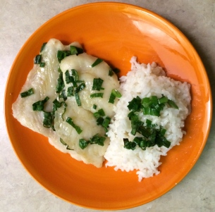 Baked swai fillet drizzled in sesame oil and green onion with rice